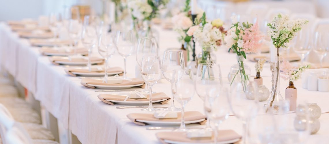 Beautyful Wedding decor. Wedding interior. Festive decor. Bouquet from spring flowers. Table decor. Table layout. Table of newly married. Restaurant interior.